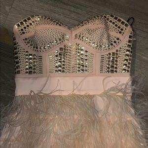 bebe Dresses - Pink nude mini dress with studs and feathers
